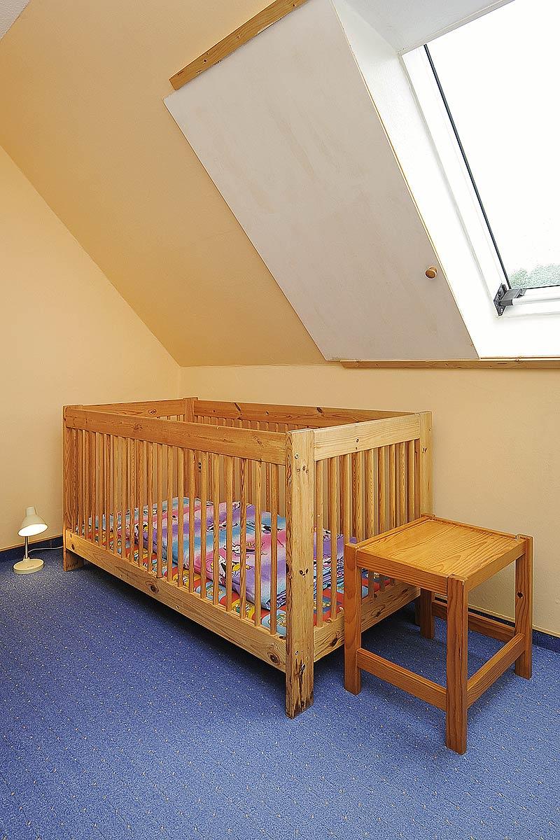 Kinderbett im Kinderzimmer der Ferienwohnung Seestern in Carolinensiel